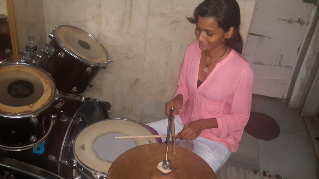 Sheetal playing drums
