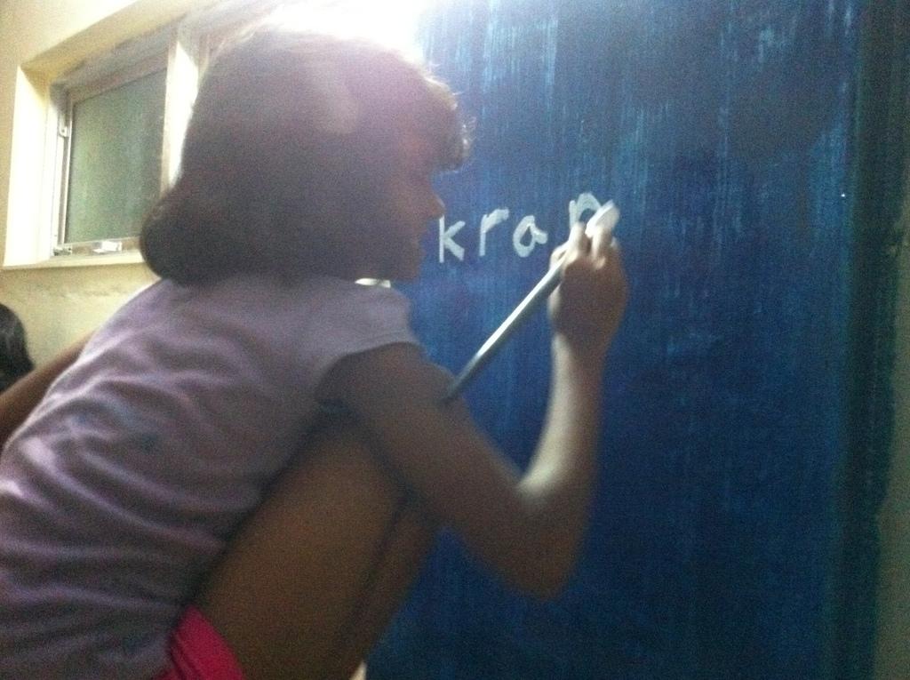 Sumaiya painting on the Kranti home walls