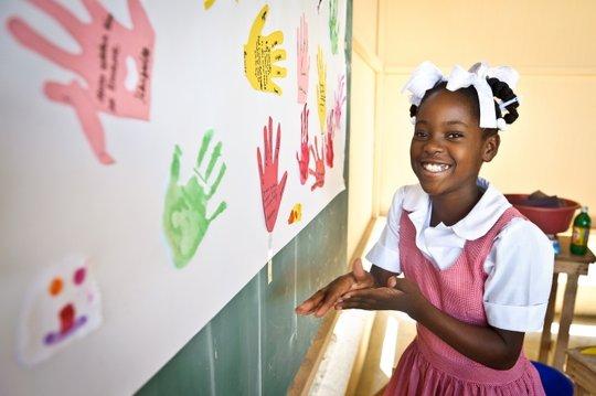 In Haiti, Abigail loves her art therapy program