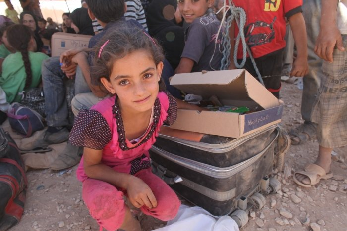 Syrian refugee 7 year old Wiam in Jordan waits