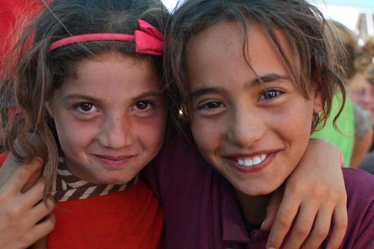 Amani and Lyat play at Za'atari's new playground