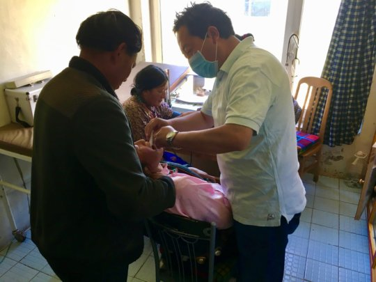 Dr. Phuntsok treating a patient