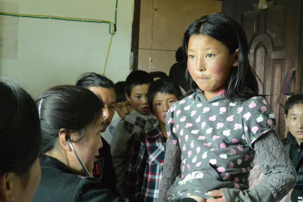 Young Khampa Girl examination