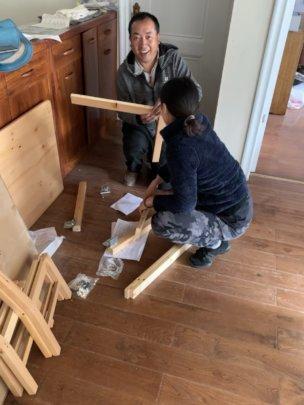 Volunteers assembling furniture