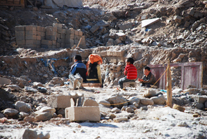 children playing in the rubble