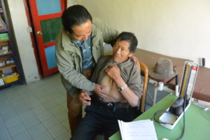 Dr. P treating a patient
