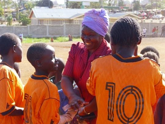Teacher celebrates with football team