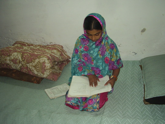 Husna studying at home
