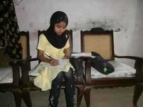 Amna doing homework