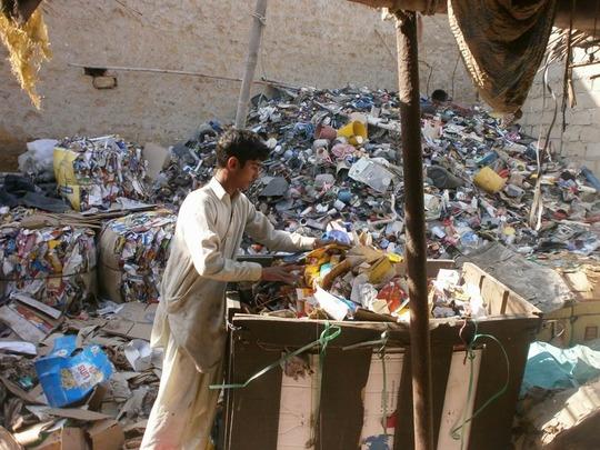 Azeem at his father's scrap shop