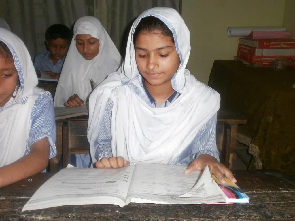 Sana reading in class