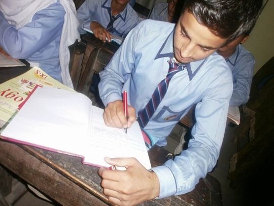 Khanzaib working on an assignment