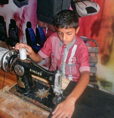 Ahsan: An aspiring engineer stitching car seats