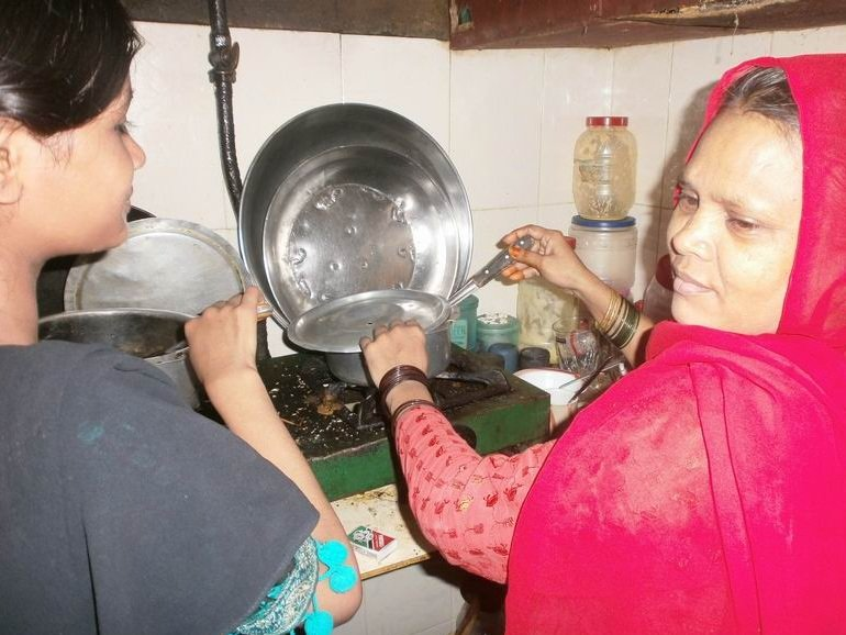 Helping her mother with household chores