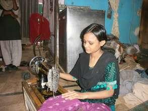 Alisha makes 50 Rupees a day sewing clothes