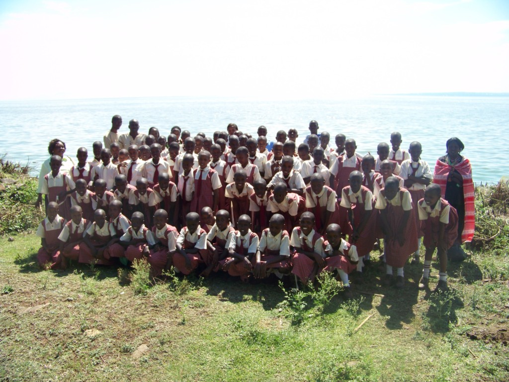 Group photo in front of Lake Victoria