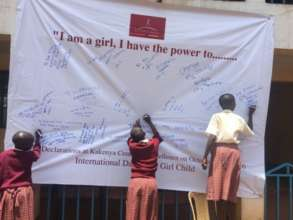 Girls adding responses to the IDG banner