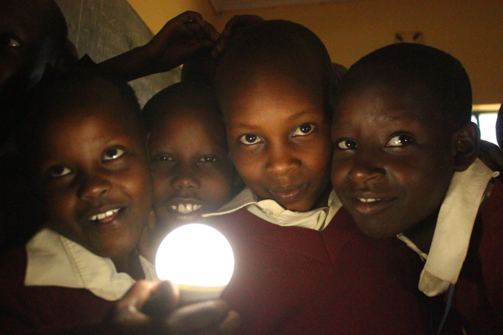 Our girls admire a new solar-powered lightbulb