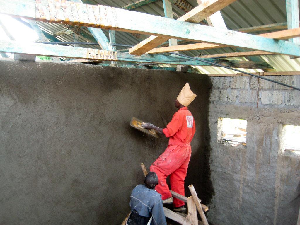 plastering the dorm walls