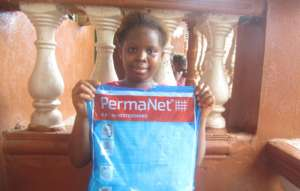 Mariama is thankful for her bed net
