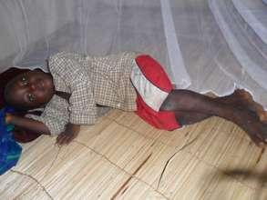 Boy under his new net
