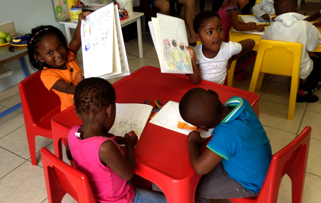 Pre-schoolers with their new workbooks