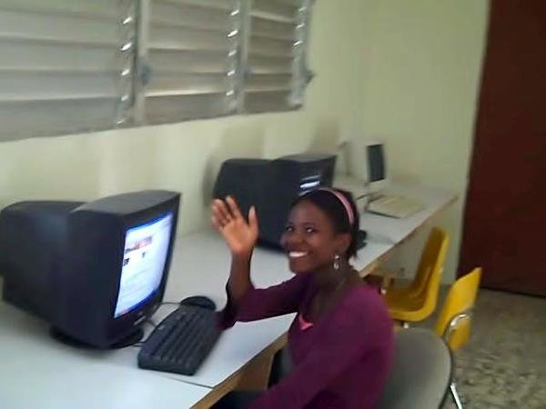 A young Adeline at one of our computers.