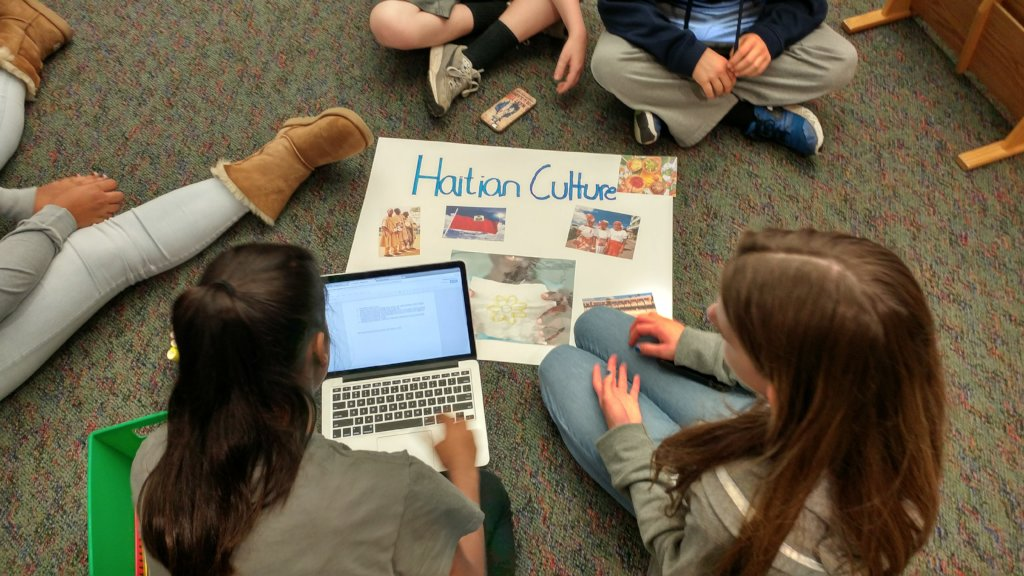 A Haitian culture poster being created