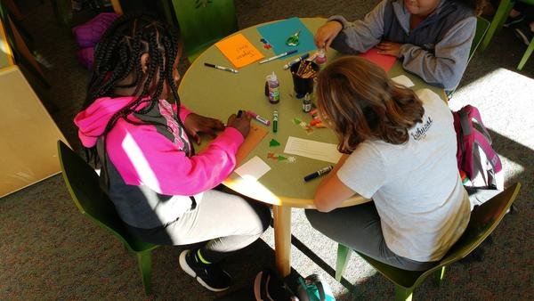 Palmyra students creating greeting cards for peers