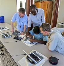 IESC team servicing a laptop with our teacher