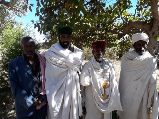With elders and village opinion makers