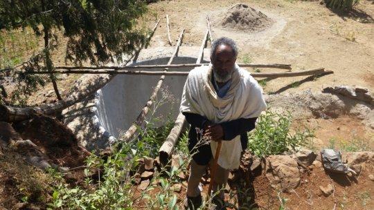 Hailu W Nerea building water pond - by A. Gebru