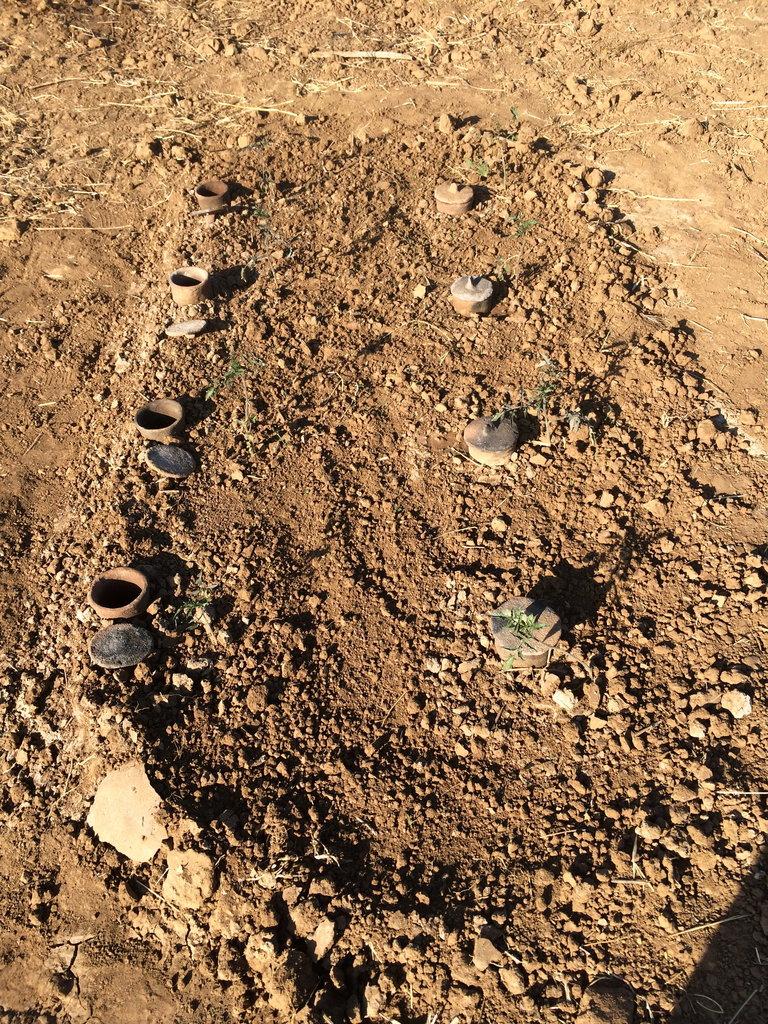 Bar shaped buried clay pots-A. Gebru
