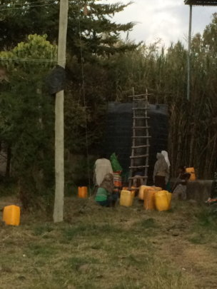 people fetching water from the water harvesting