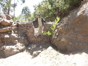 the first gabion check dam half filled with sand