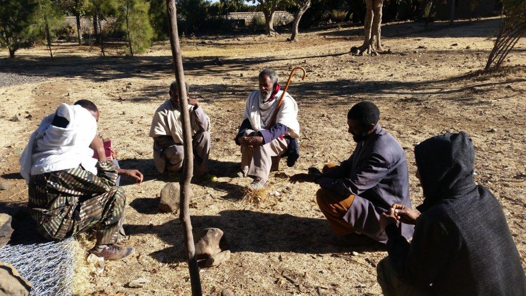 Elders discussing the repair, by Amanuel Gebru