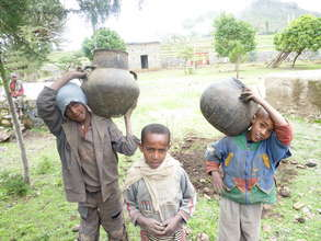school children bring the clay pots
