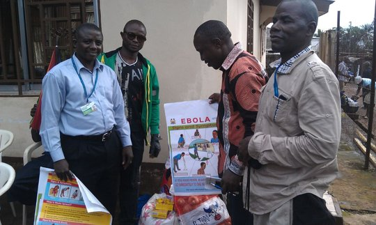 Phillip Sesay teaching the community about Ebola