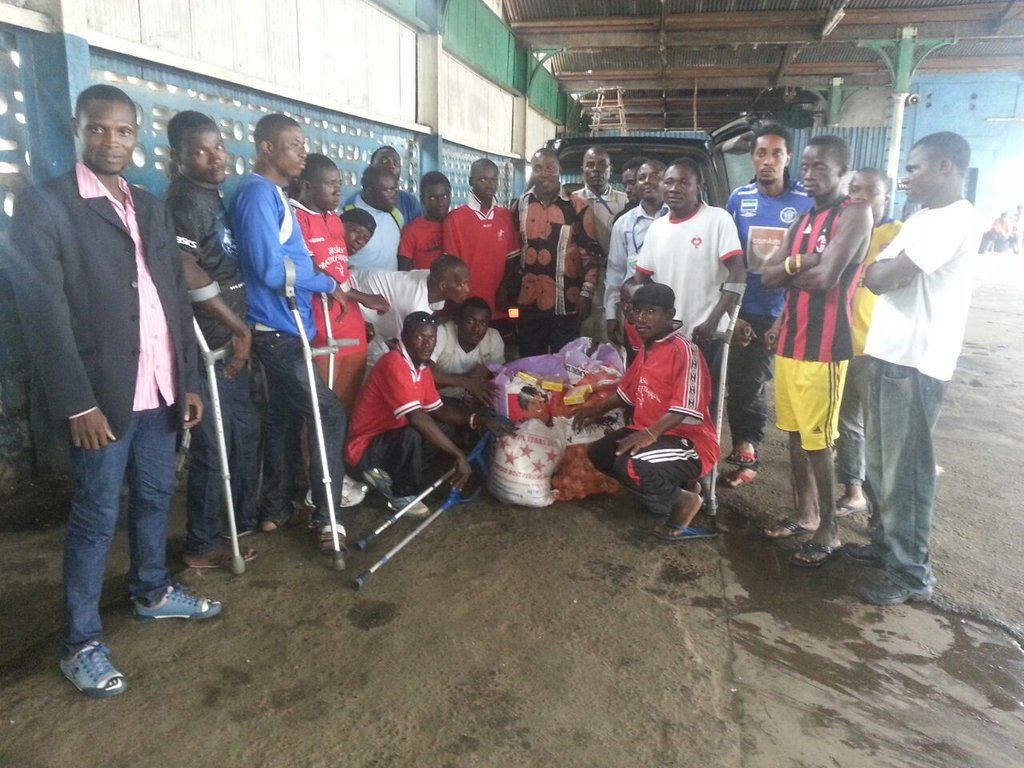 Amputees recieving the food items