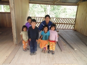 Eusebio and children in the ecohostel's 2nd floor