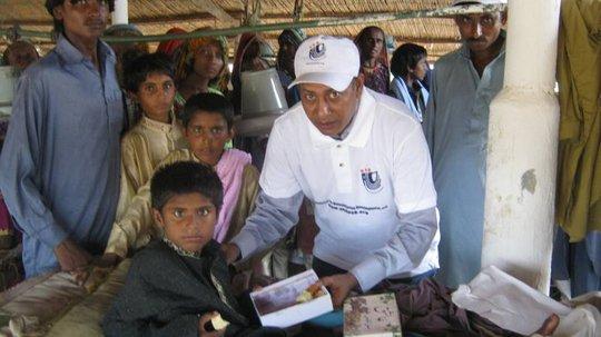Injured Child during floods happy get EID gift