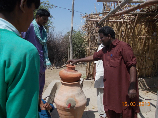 AHD staff giving instructions to village families
