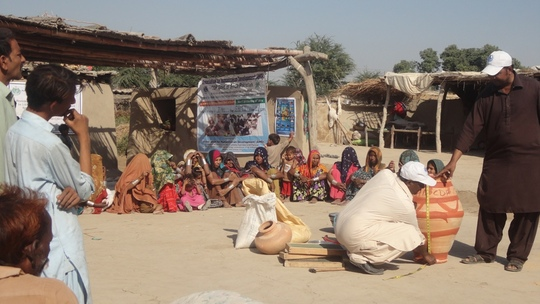 AHD staff giving training to village families