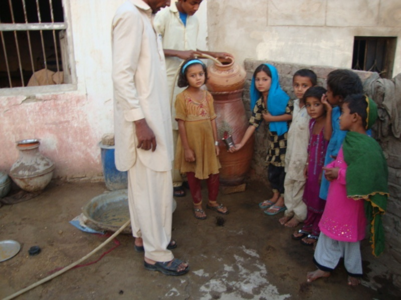 Children taking water from filter