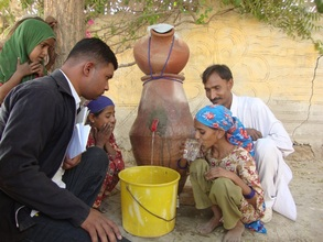 Girl drinking safe drinking water