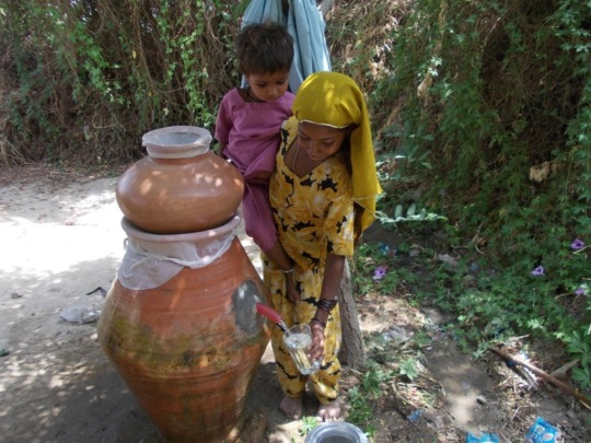 Clean drinking water access by young girl