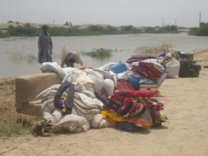IDP of flood living on open air