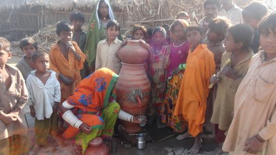 Mrs. Jeeti Chettan filling glass for Nadi water
