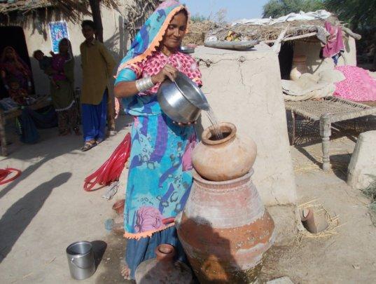 Women happily using Nadi filter