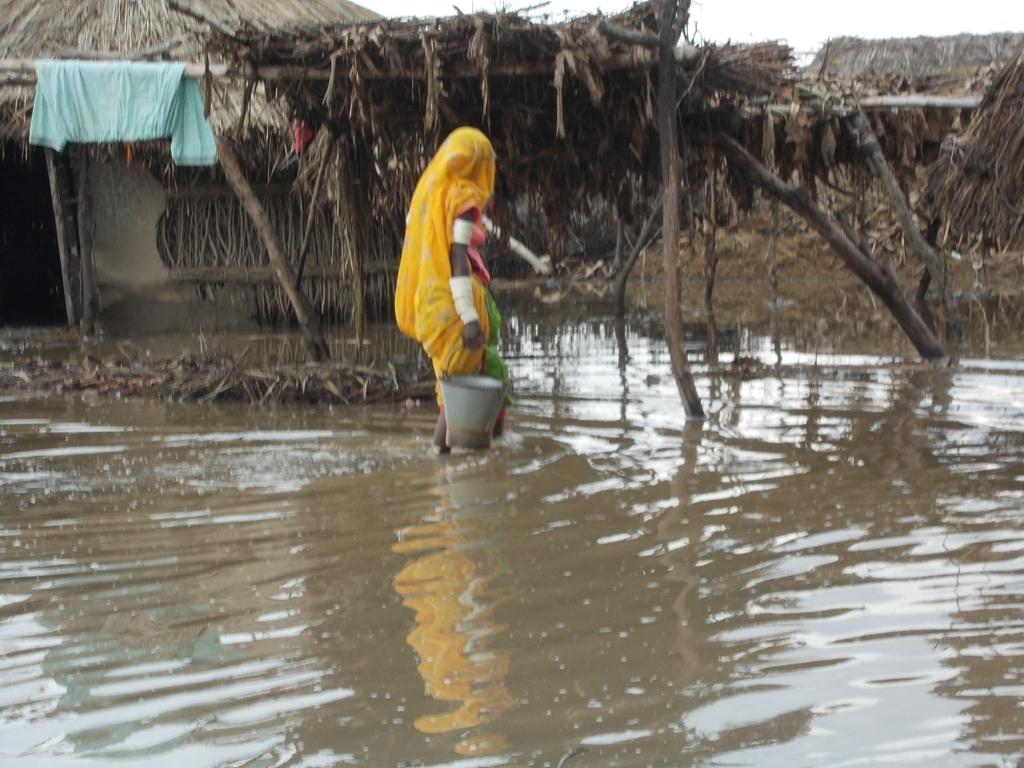 Women walking in flood water to go home